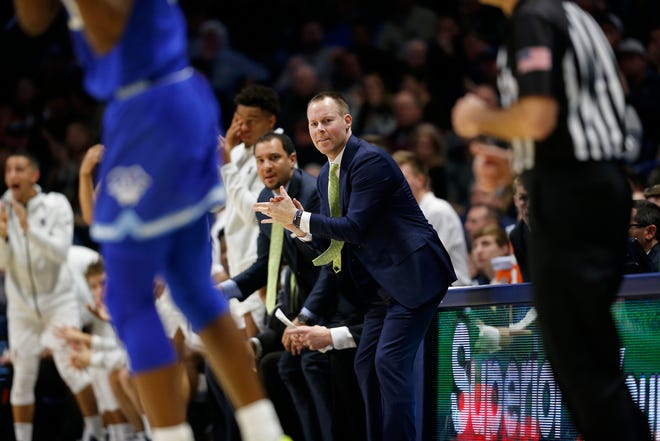 Xavier Musketeers head coach Travis Steele directs his defense in the first half of the NCAA Big East conference game between the Xavier Musketeers and the Seton Hall Pirates at the Cintas Center in Cincinnati on Wednesday, Jan. 8, 2020. Seton Hall led 40-32 at halftime.
