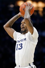 Xavier Musketeers forward Naji Marshall (13) looks for an open pass in the first half of the NCAA Big East conference game between the Xavier Musketeers and the Seton Hall Pirates at the Cintas Center in Cincinnati on Wednesday, Jan. 8, 2020. Seton Hall led 40-32 at halftime.