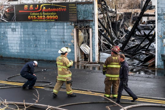 Springfield Firefighters discuss next steps after containing a structure fire at the old Carter Lumber building in Springfield, Tenn., on Thursday, Jan. 9, 2020.