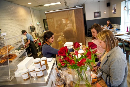 Customers purchase pastries to go after lunch at Madeleines Place in Clarksville, Tenn., on Thursday, Jan. 9, 2020.
