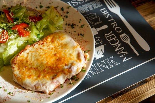 A Croque Monsieur is plated with fresh salad at Madeleines Place in Clarksville, Tenn., on Thursday, Jan. 9, 2020.