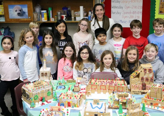 Washington fourth graders in Elizabeth Reilly's class participated in a seasonal STEM project in December that combined technology, teamwork, and… gingerbread.