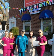 Dr. Naum Polonskiy, D.V.M. (center),  flanking by (left to right): Diana Ryjova, office manager; Julie Tankelevich, veterinary technician; Perth Amboy Mayor Wilda Diaz, and Tanya Sharipova, veterinary technician.