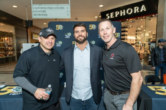 Hundreds came out to the Bridgewater Commons Mall Thursday to celebrate 50 years of the New Jersey Lottery. From left to right:  NY Jets Alumni, Wayne Chrebet,  NY Yankee, and Jersey native, Mike Ford and NJ Devils Alumni, Grant Marshall.