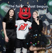 Hundreds came out to the Bridgewater Commons Mall Thursday to celebrate 50 years of the New Jersey Lottery. From left to right: New Jersey Lottery Draw Host, Lauren Berman, New Jersey Devils mascot, NJ Devil and Instagram Influencer, Teggy French.