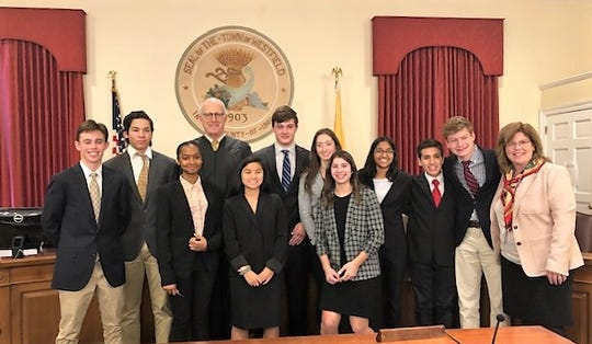 Union County Superior Court Judge James Hely presided over a mock trial conducted by Westfield High School students on Monday, Dec. 16. Students in Kimberly Leegan's Mock Trial class presented a fictitious case of a student injured while taking a selfie after sneaking out after curfew during a school-sponsored overnight field trip. The student legal eagles acted as prosecutors, defense attorneys, and witnesses, providing opening and closing statements, direct and cross-examinations during presentation of the fictitious case. Eighth graders from Joseph Perrino's Mock Trial and Debate Class at Roosevelt Intermediate School in Westfield also attended and served as jurors.