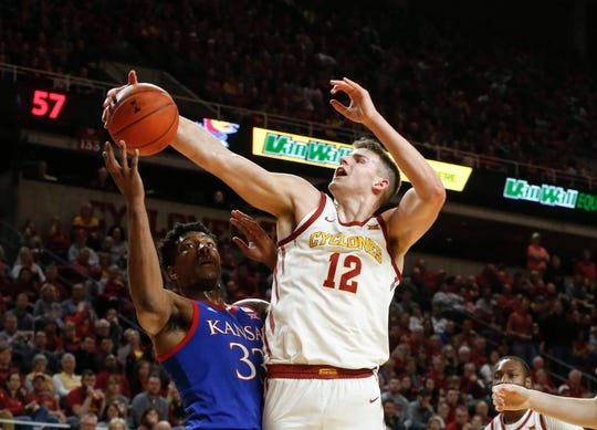 Iowa State senior Michael Jacobson swats the ball away from Kansas sophomore David McCormack in the second half on Wednesday, Jan. 8, 2020, at Hilton Coliseum in Ames.
