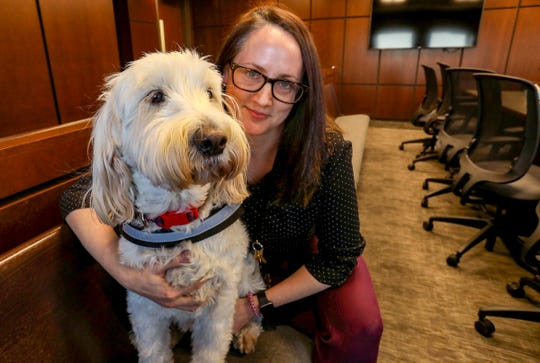 Izzy with Amy Mitchell, a casework supervisor and  the Goldendoodle's handler, at the Macomb County Juvenile Court in downtown Mt. Clemens on December 29.