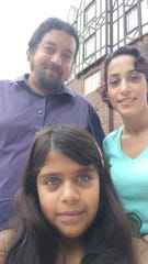 Shervin Assari with his wife, Maryam and then-8-year-old daughter at the University of Michigan in 2018.