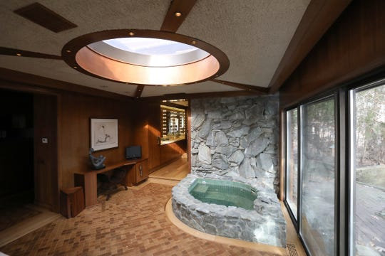 """A sunken stone spa is the next space off the owner's bedroom with a long walk-in closet at its left. The room beyond is the """"no-bathroon"""" bathroom that is all wood, not tile, with most fixtures hidden. The skylight is one of many added to the house in Bloomfield Township, Michigan on January 7, 2020."""