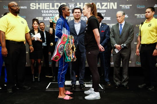 Claressa Shields, left, and Ivana Habazin face off after the weigh-in for their fight on Friday, Jan. 9, 2020, in Atlantic City.