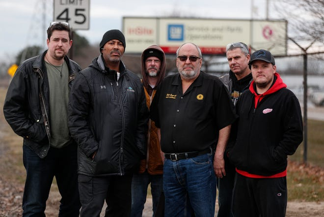 From left, day shift workers Erik Brzezinski of Westland, Mike Martin of Farmington Hills, Jason Gravenmier of Westland, Bill Bagwell of Westland, Todd Canterbury of White Lake and Nolan Kerr of Allen Park pose for a photo outside of General Motors' Customer Care and Aftersales (CCA) plant in Ypsilanti, Thursday, Jan. 9, 2020.