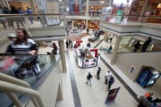 In this Nov. 29, 2019, file photo shoppers check out the Black Friday sales at Valley View Mall in Roanoke, Va. Mall-based retailers J.C. Penney, Kohl's and Victoria's Secret parent reported sales declines for the holiday season, underscoring  continued challenges ahead from online rivals.