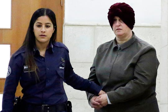 This Feb. 27, 2018 file photo, Australian Malka Leifer, right, is brought to a courtroom in Jerusalem. An Israeli psychiatric panel has determined that Leifer facing dozens of sex-abuse charges in Australia is fit to stand trial for extradition, the Justice Ministry confirmed Thursday, Jan. 9, 2020.