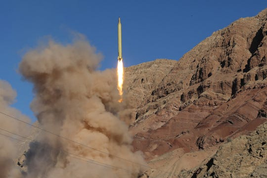 A long-range Qadr ballistic missile is launched in the Alborz mountain range in northern Iran on March 9, 2016.