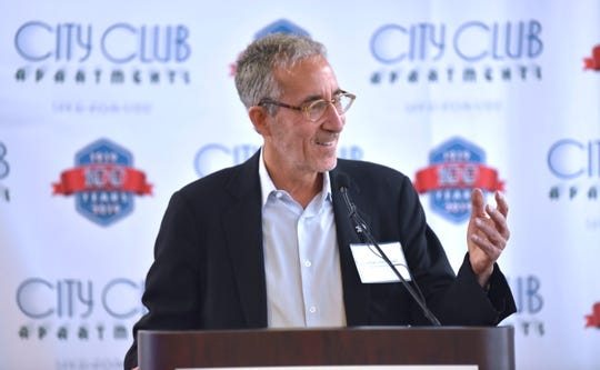 City Club Apartments co-founder and CEO Jonathan Holtzman addresses attendees in the ceremonial groundbreaking at the City Club Apartments on Thursday.