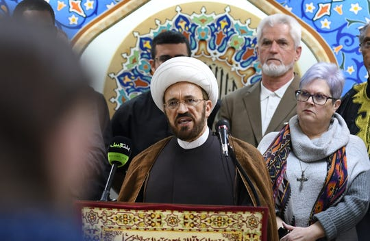 Imam Mohammed Elahi of the Islamic House of Wisdom takes a stand with fellow leaders of the Iranian-American community during a news conference Thursday.