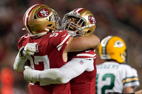 Nick Bosa, left, Arik Armstead and the 49ers led the NFL in total defense this season.