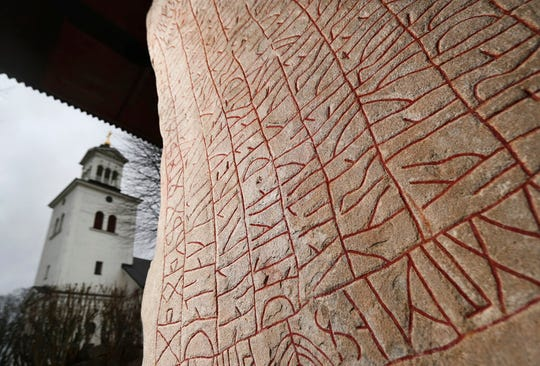 A Viking-era runic stone in front of the Rok Church near the Lake Vattern and the town of Odeshog, Sweden, Thursday Jan. 9, 2020. The stone dated to the 9th century could have been raised out of fear of a climate disaster, says a new study.