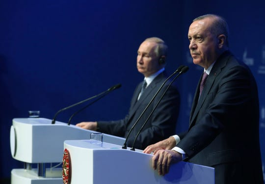 Turkish President Recep Tayyip Erdogan, right, and Russian President Vladimir Putin speak during a ceremony for the dual natural gas line, TurkStream, connecting their countries, in Istanbul, Wednesday, Jan. 8, 2020.