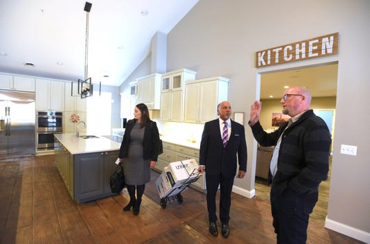 House of Providence co-founder Jason Dunn, right, gives a tour of the Girls Home to his attorneys, Joseph N. Ejbeh of Shelby Township and Nina M. Paolini-Lotarski of Rochester Hills.