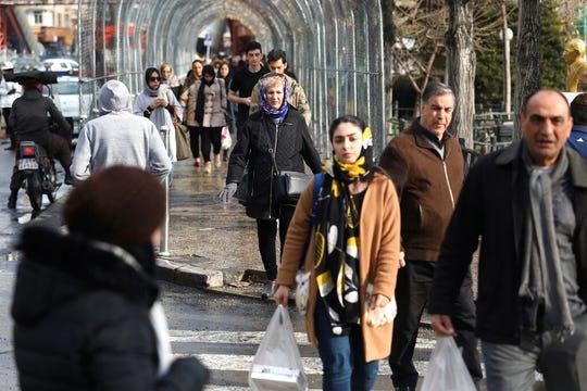 Pedestrians walk in Tajrish square in northern Tehran, Iran, Thursday, Jan. 9, 2020.