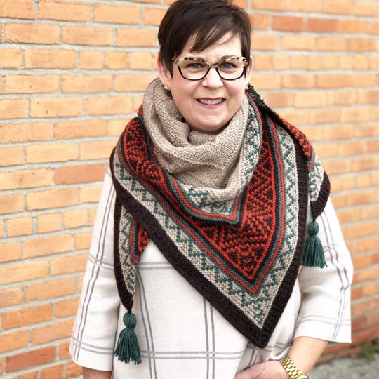 "Bridget Dean, owner of ""...have you any Wool?,"" wears a knitted Boho Style Mosaic Shawl."