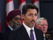 Prime Minister Justin Trudeau holds a news conference updating the Iran plane crash in Ottawa on Thursday, Jan. 9, 2020, as Defense Minister Harjit Sajjan, left, and Chief of Defense Staff Jonathan Vance look on.