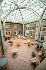 The renovated courtyard was originally outdoors but is now enclosed, allowing year-round use.