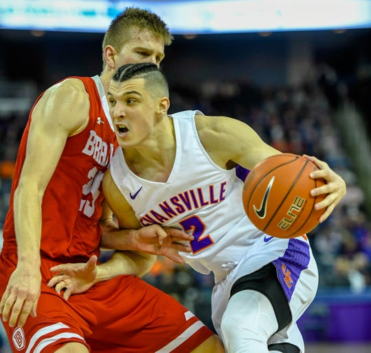 Evansville's Artur Labinowicz (2) tries to turn the corner against defense from Bradley's Nate Kennell (23) as the University of Evansville Aces play the Bradley University Braves at the Ford Center Wednesday evening, January 8, 2020.