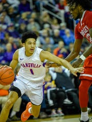 Evansville's Marcus Henderson (1) drives the baseline as the University of Evansville Aces play the Bradley University Braves at the Ford Center Wednesday evening, January 8, 2020.