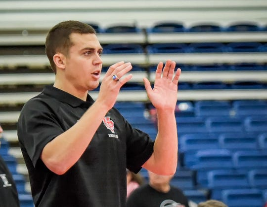 Cody Moll, who guided North Posey to its first team state wrestling title, also was a member of Mater Dei championship teams.