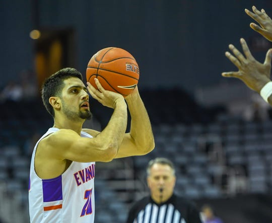 Evansville's Sam Cunliffe (20) takes a jump shot as the University of Evansville Aces play the Bradley University Braves at the Ford Center Wednesday evening, January 8, 2020.