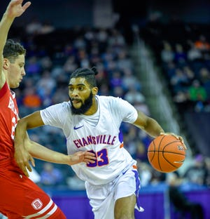 Evansville's K.J. Riley (33) drives against Bradley's Ville Tahvanainen (23) as the University of Evansville Aces play the Bradley University Braves at the Ford Center Wednesday evening, January 8, 2020.