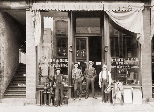 The original D. Ahern & Son storefront at what is now 17 S. Main St. Pictured are J. F. Ahern, second from right, and David Ahern, far right.