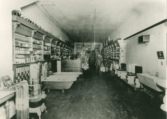 Pictured is the original showroom of D. Ahern & Son at what is now 17 S. Main St. The showroom included fixtures, tubs, toilets and more.