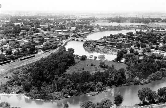 "Before construction of Fremont's floodwall in the 1970s, the Sandusky River formed an oxbow formed an ""oxbow"" and during the Great Depression was the site of the ""dangerous"" Hobo Jungle."