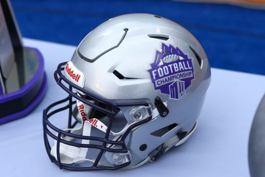 A Mountain West Championship helmet is seen on the field at Albertsons Stadium prior to kick off between the Hawaii Warriors and the Boise State Broncos.