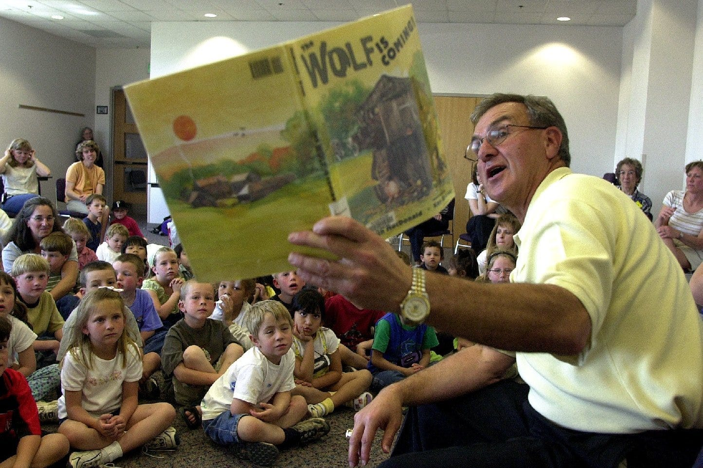 Sonny Lubick reads 'The Wolf is Coming' to children and parents at a Read-Aloud Day event in 2001.