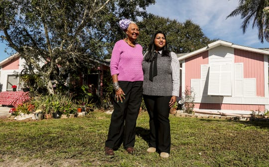 Cape Coral resident, Monica Dunkley, left,  stands for a portrait with Shanthy Balachanthiran, Esq. LITC Director & Supervising Associate Florida Rural Legal Services in front of her home on Wednesday Jan. 8, 2020. Dunkley feared she could lose her home due to tax penalties. Florida Rural Legal Services has a relatively new service that offers free help for low income residents. Dunkley was saved by this service.