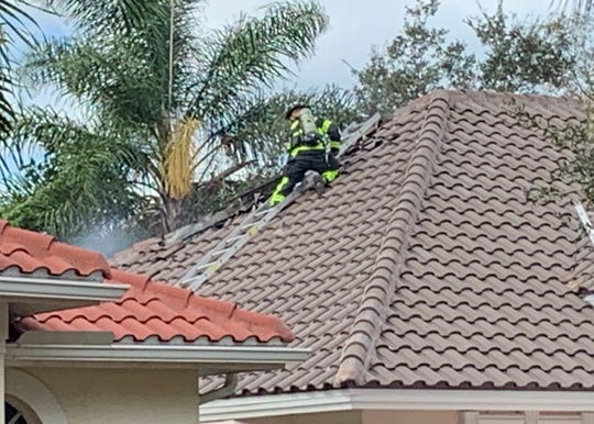 Workers grinding bolts on a beam accidentally sparked a fire that caused flame and smoke damage Thursday to a home in the Pinewood Lakes development in Gateway.