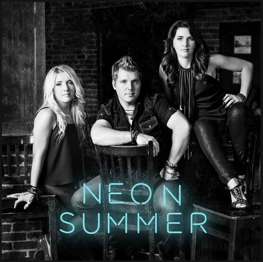 Country trio Neon Summer are (from left to right) Anna Ash, Marty Short and Angela Short.