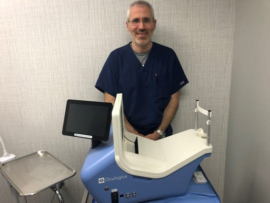 Dr. Ron Elfenbein, a physician in Gambrels, Maryland, at the time of the photo, shows off Oculogica's EyeBOX device. The EyeBOX conducts an eye test that can aid in the diagnosis of concussions while patients watch a four-minute video.