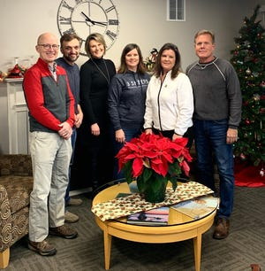 Frozen Spoon founders handed their keys over to Anthony Sikora on Dec. 27. Pictured from left: Coldwell Bank Real Estate Group representative Scott Bader, Anthony Sikora, ERA Starr Realty representative Dina Boettcher, Jolene McMahon, Jenny Van Dreese and Steve Van Dreese.
