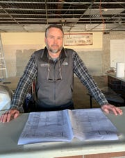 Thomas Wirthlin, developer and general contractor of the planned Warehouse at Vaughn's concept in downtown Simpsonville, poses for a photo inside the space on Thursday, Jan. 9, 2020.