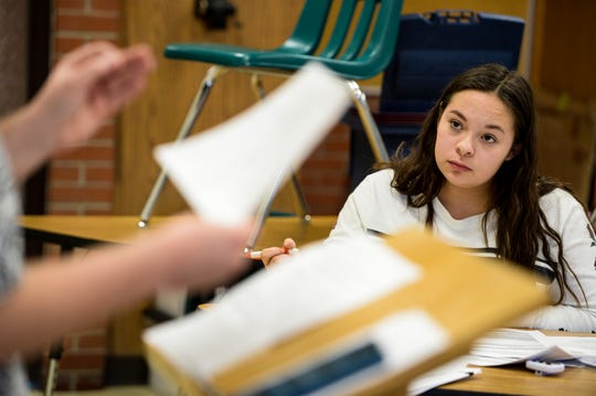 Gracie Galves listens to a teammate during CMR speech and debate team practice on Tuesday evening, January 7.