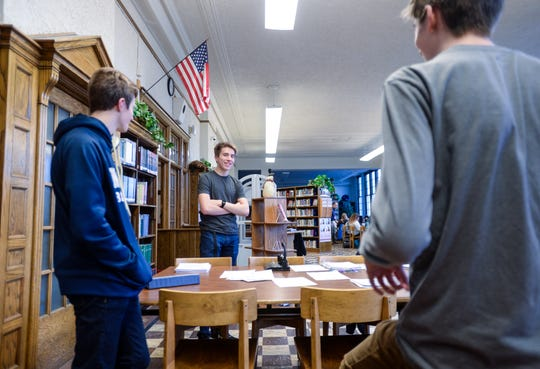 Valon Haslem, center, discusses the upcoming speech and debate meet, hosted by Great Falls Central Catholic High School, with his Great Falls High teammates Taylor Radonich, left, and Brady Habel during Wednesday's practice in the library at Great Falls High.
