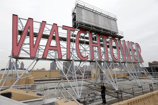 The iconic Watchtower sign is seen in 2015 on the roof of 25-30 Columbia Heights, then world headquarters of the Jehovah's Witnesses, in the Brooklyn borough of New York.
