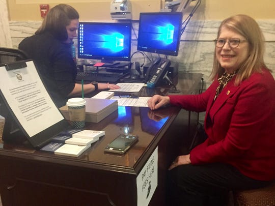 Debra Lamm, Republican candidate for the U.S. House seat, files to run on Thursday at the Secretary of State's office.