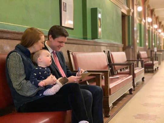 Great Falls native Raph Graybill, a Democrat, files for attorney general at the Montana Secretary of State's Office at the opening of filing Thursday, alongside his wife Marisa, and 9 month-old daughter Genevieve.